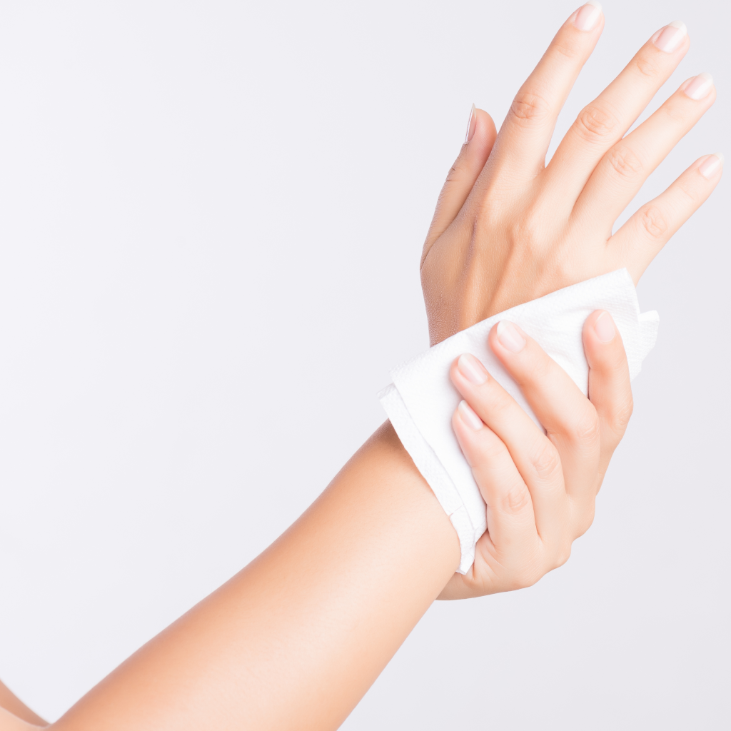 hand cleaning with a wet wipe