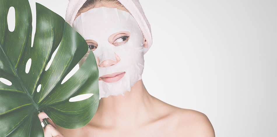 woman with a face sheet mask